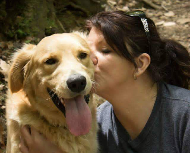 Nancy Chambers is pictured with her golden retriever, Tate, during a hike in the Big South Fork National River & Recreation Area.